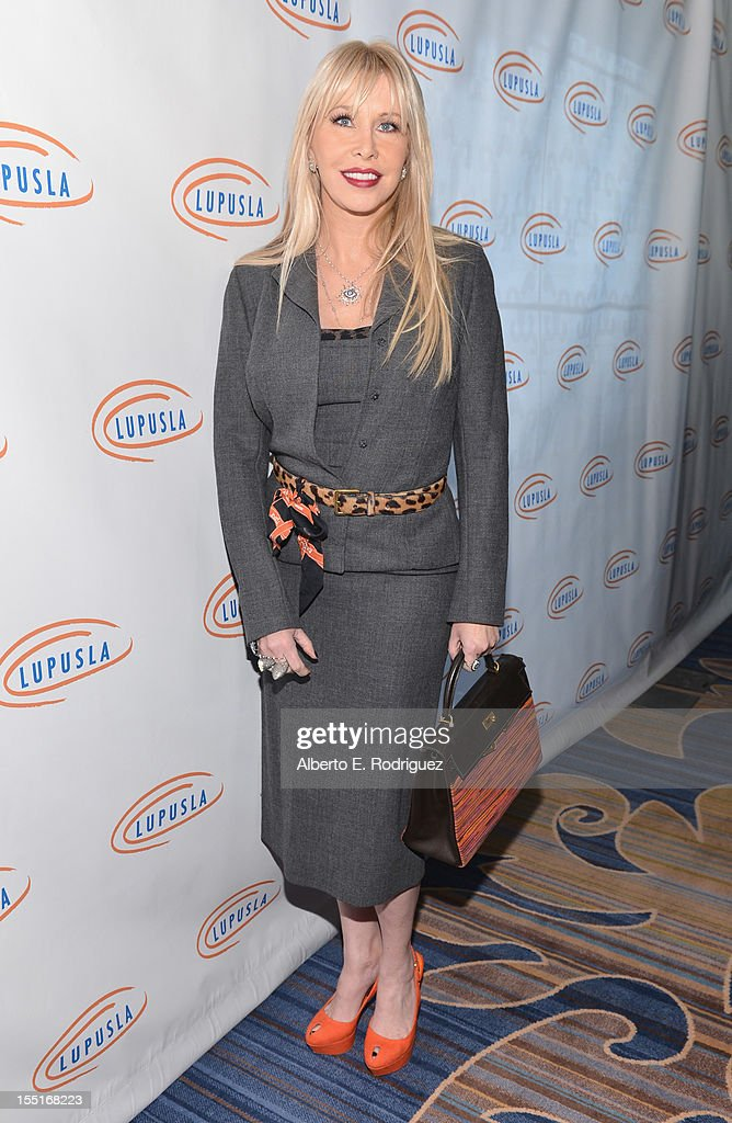 TV personality Lisa Gastineau arrives to the Lupus LA 10th Anniversary Hollywood Bag Ladies Luncheon at Regent Beverly Wilshire Hotel on November 1, 2012 in Beverly Hills, California.