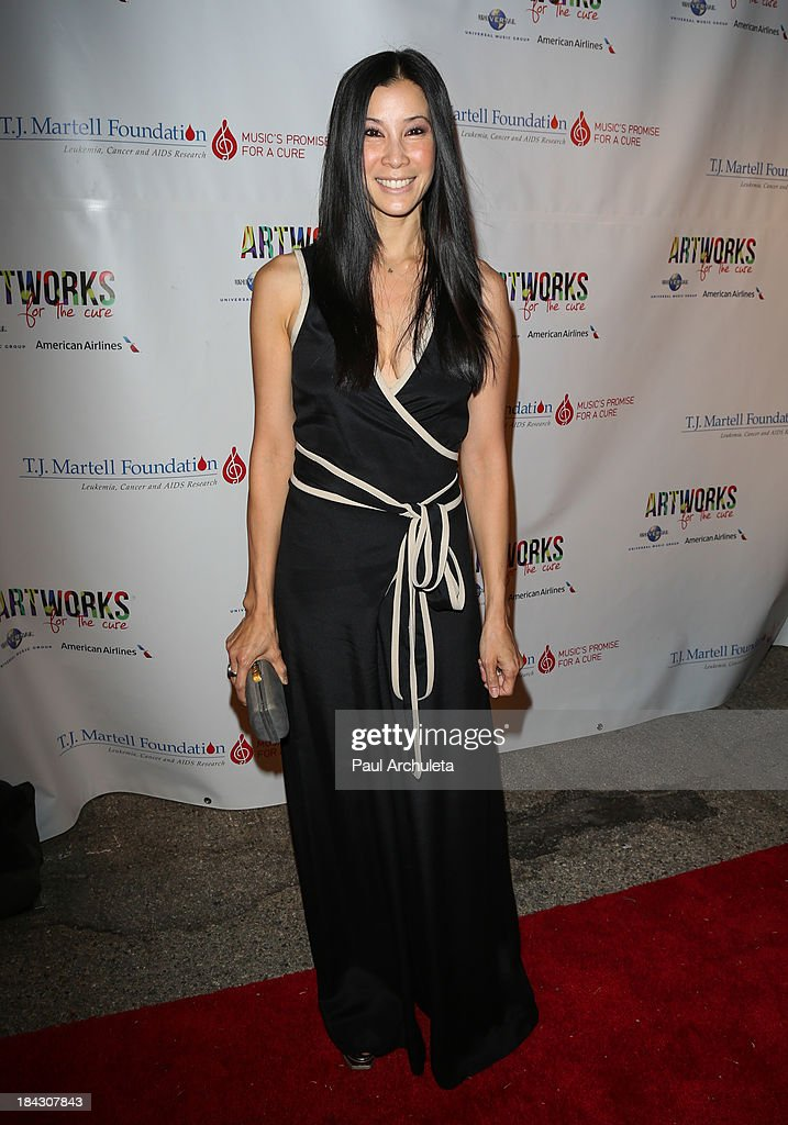 Personality Lisa Ling attends The TJ Martell Foundation's 3rd annual Artworks For The Cure charity event at Barker Hangar on October 12 2013 in Santa...