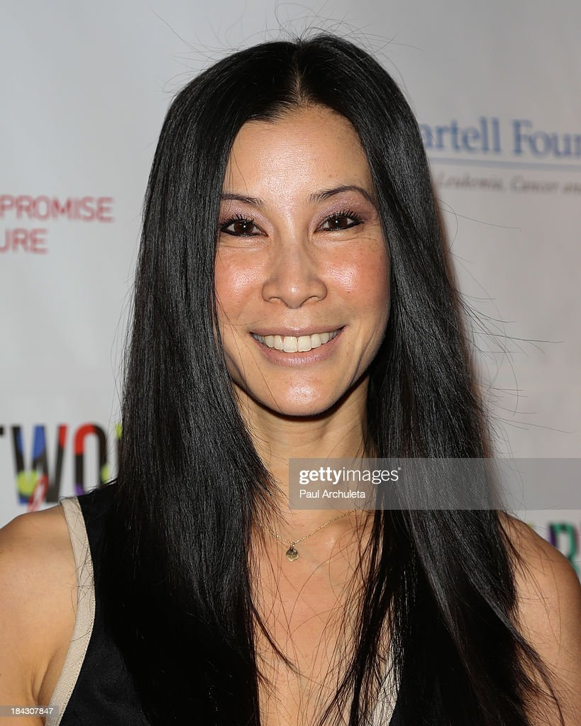 TV Personality <a gi-track='captionPersonalityLinkClicked' href=/galleries/search?phrase=Lisa+Ling&family=editorial&specificpeople=240577 ng-click='$event.stopPropagation()'>Lisa Ling</a> attends The T.J. Martell Foundation's 3rd annual Artworks For The Cure charity event at Barker Hangar on October 12, 2013 in Santa Monica, California.