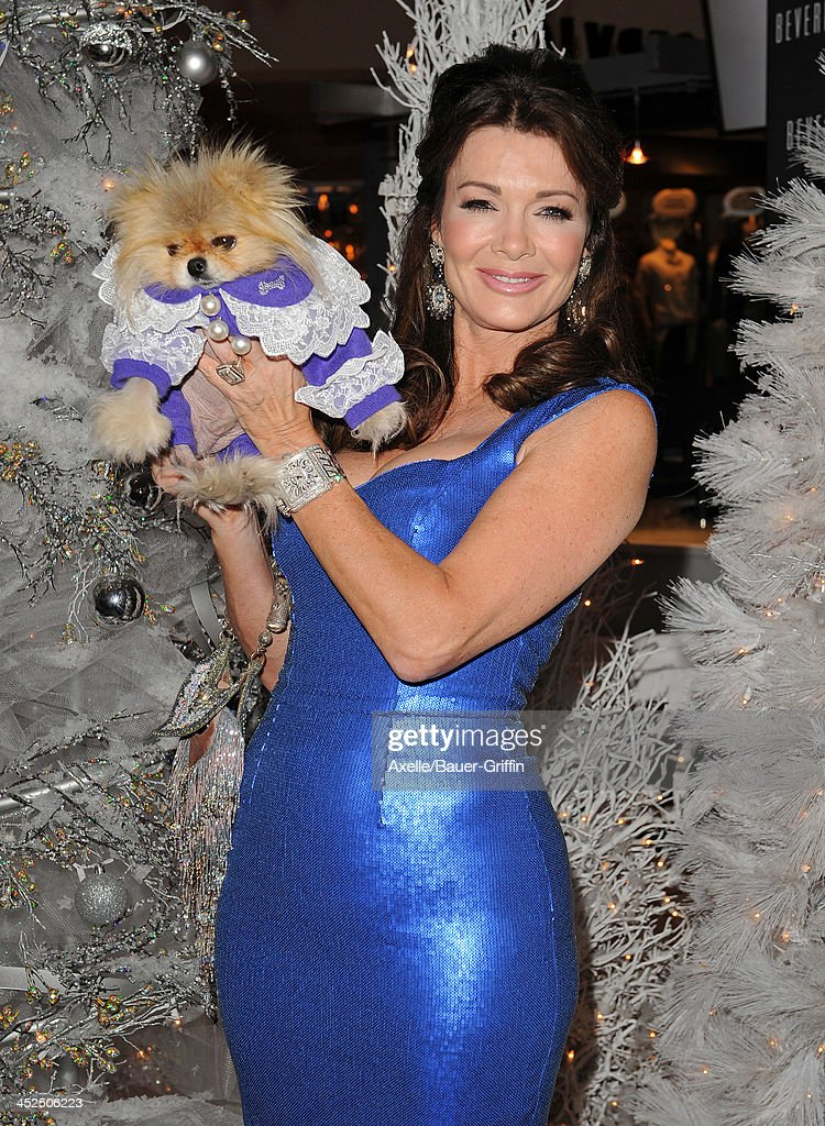 TV personality <a gi-track='captionPersonalityLinkClicked' href=/galleries/search?phrase=Lisa+Vanderpump&family=editorial&specificpeople=6834933 ng-click='$event.stopPropagation()'>Lisa Vanderpump</a> and dog Giggy attend The Beverly Center Kicks Off 'Holiday Pet Portraits With Santa!' at The Beverly Center on November 14, 2013 in Los Angeles, California.