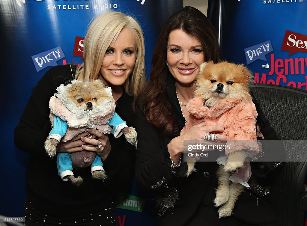 TV personality Lisa Vanderpump and her dogs Giggy and Harrison pose for a photo with host Jenny McCarthy (L) during a visit to 'Dirty, Sexy, Funny with Jenny McCarthy' at the SiriusXM Studios on March 15, 2016 in New York City.
