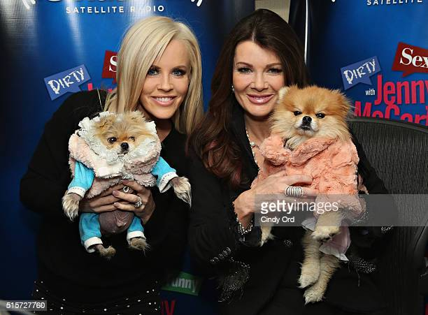 TV personality Lisa Vanderpump and her dogs Giggy and Harrison pose for a photo with host Jenny McCarthy during a visit to 'Dirty Sexy Funny with...