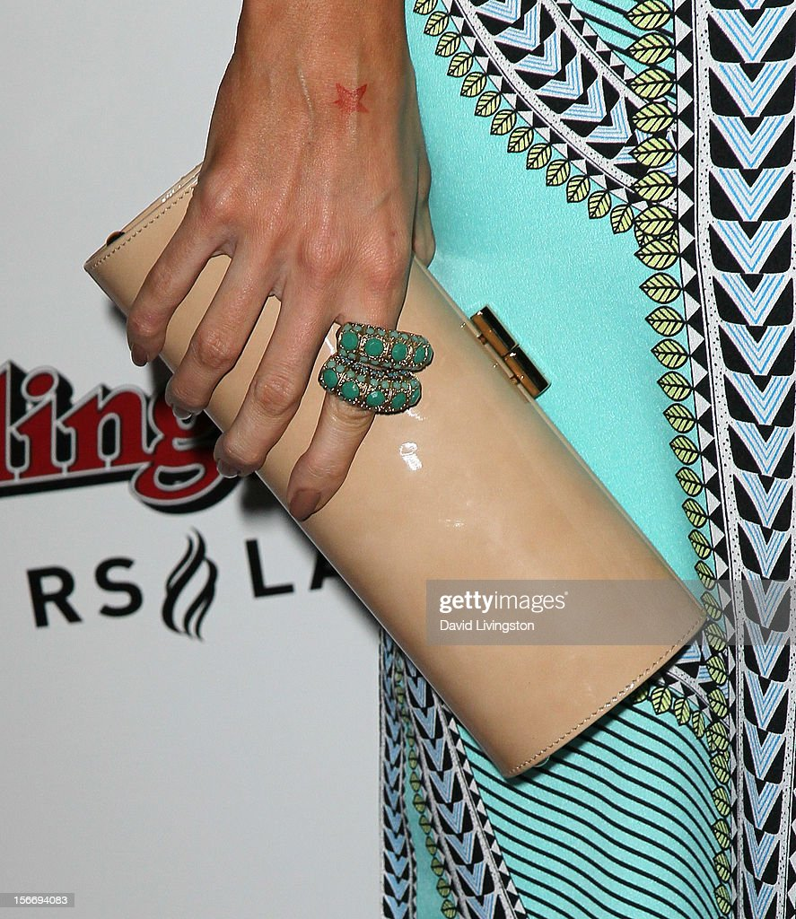 TV personality Louise Roe (purse & ring detail) attends Rolling Stone Magazine's 2012 American Music Awards (AMAs) VIP After Party presented by Nokia and Rdio at the Rolling Stone Restaurant and Lounge on November 18, 2012 in Los Angeles, California.