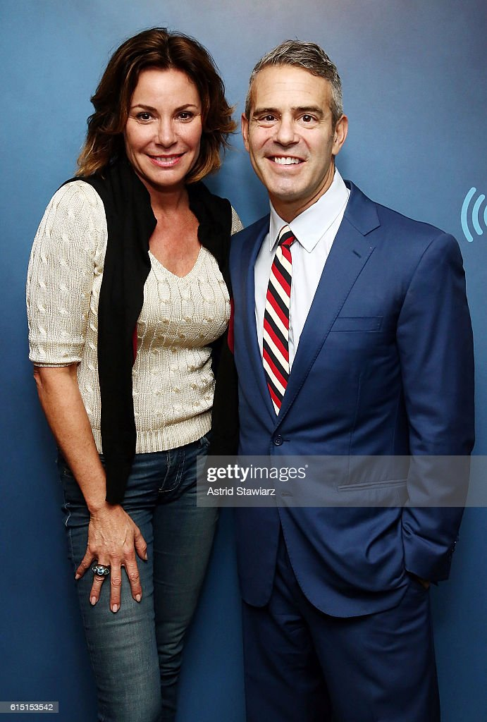 TV personality Luann de Lesseps poses with host Andy Cohen during a taping of SiriusXM's 'Radio Andy' at the SiriusXM Studios on October 17, 2016 in New York City.