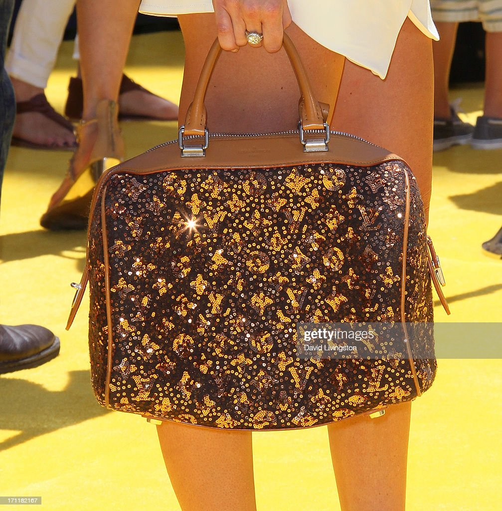 TV personality Lydia McLaughlin (purse detail) attends the premiere of Universal Pictures' 'Despicable Me 2' at the Gibson Amphitheatre on June 22, 2013 in Universal City, California.