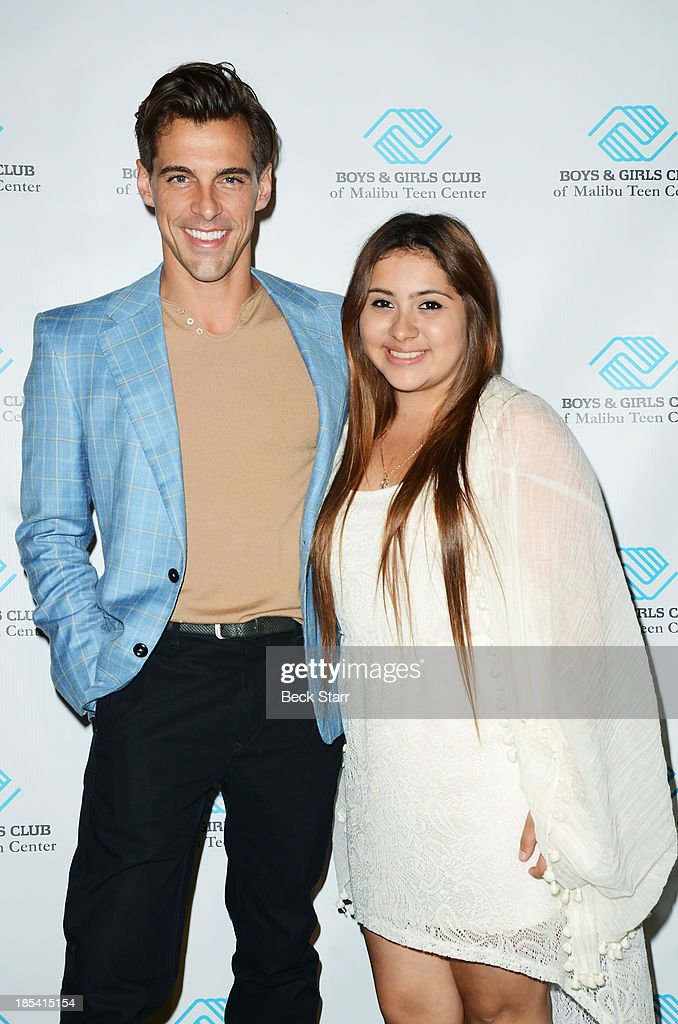 TV personality Madison Hildebrand and 2013 BGCM Youth of the year Mariarely Cruz arrive at the Malibu Boys And Girls Club Fundraiser to introduce the 2013 BGCM Youth of the Year on October 19, 2013 in Malibu, California.