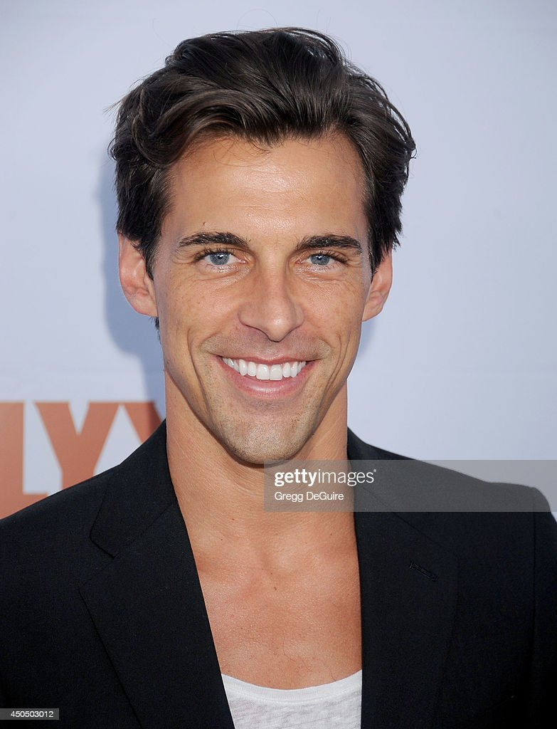 TV personality Madison Hildebrand arrives at the Pathway To The Cures For Breast Cancer event at Barkar Hangar on June 11, 2014 in Santa Monica, California.