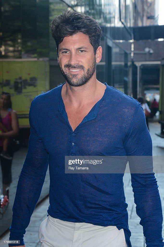 TV personality <a gi-track='captionPersonalityLinkClicked' href=/galleries/search?phrase=Maksim+Chmerkovskiy&family=editorial&specificpeople=4251170 ng-click='$event.stopPropagation()'>Maksim Chmerkovskiy</a> enters the 'Good Day New York' taping at the Fox 5 Studios on July 18, 2013 in New York City.