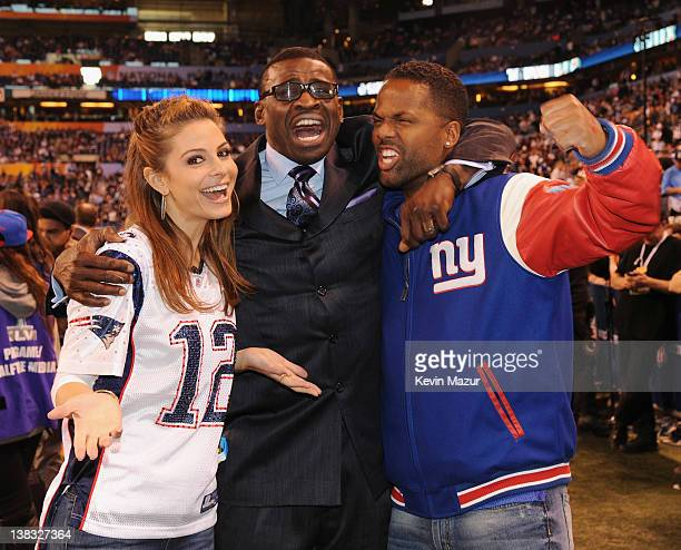 TV personality Maria Menounos and AJ Calloway pose with former NFL player and broadcaster Michael Irvin attend the Bridgestone Super Bowl XLVI...