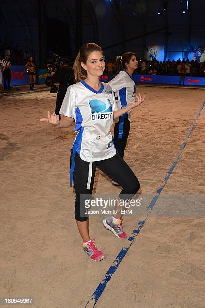 TV personality Maria Menounos attends DIRECTV'S Seventh Annual Celebrity Beach Bowl at DTV SuperFan Stadium at Mardi Gras World on February 2 2013 in...