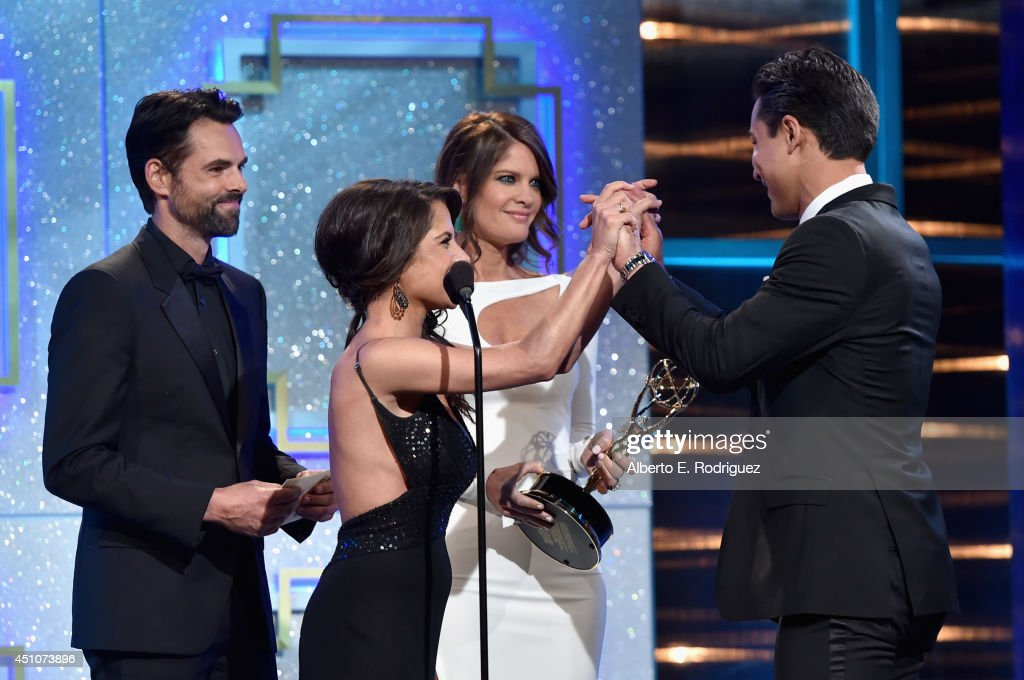 TV personality Mario Lopez accepts Outstanding Entertainment News Program for 'Extra' from actors Jason Thompson Kelly Monaco and Michelle Stafford...