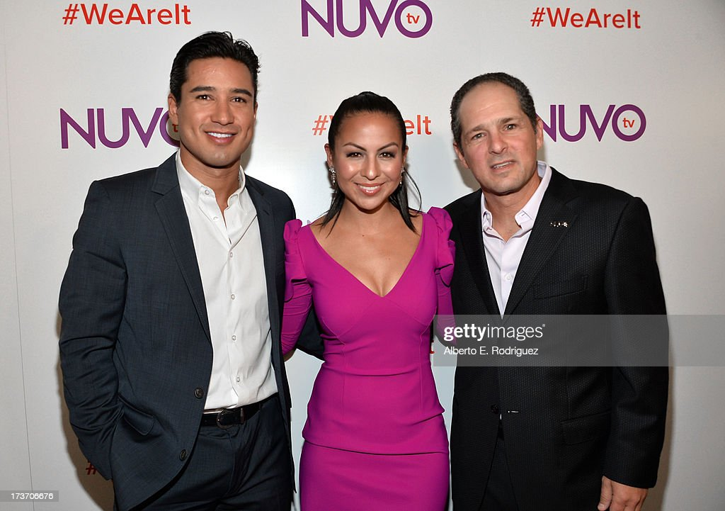 TV personality <a gi-track='captionPersonalityLinkClicked' href=/galleries/search?phrase=Mario+Lopez&family=editorial&specificpeople=235992 ng-click='$event.stopPropagation()'>Mario Lopez</a>, actress/comedian Anjelah Johnson and NUVOtv Chief Executive Officer Michael Schwimmer arrive at the NUVOtv Network Launch Party at The London West Hollywood on July 16, 2013 in West Hollywood, California.