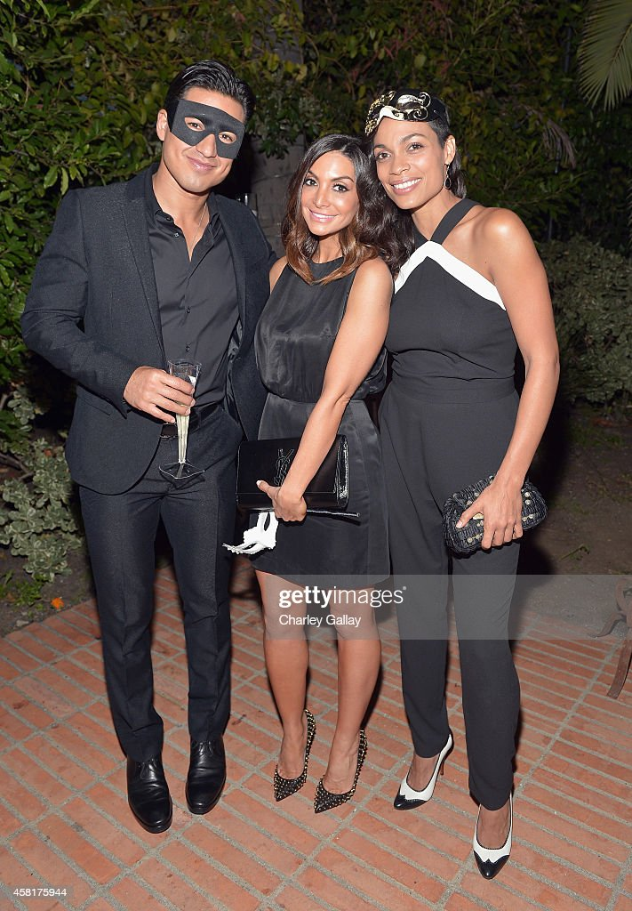 TV personality Mario Lopez and actors Courtney Laine Mazza and Rosario Dawson enjoy Veuve Clicquot at The UNICEF Dia de los Muertos Black White...