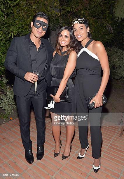 TV personality Mario Lopez and actors Courtney Laine Mazza and Rosario Dawson enjoy Veuve Clicquot at The UNICEF Dia de los Muertos Black White...