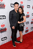 TV personality Mario Lopez and Courtney Laine Mazza attend the iHeartRadio Music Awards at The Forum on April 3 2016 in Inglewood California