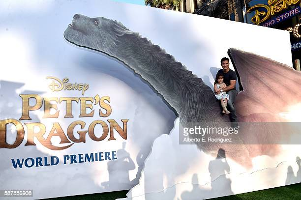 TV personality Mario Lopez and Gia Francesca Lopez arrive at the world premiere of Disney's 'PETE'S DRAGON' at the El Capitan Theater in Hollywood on...