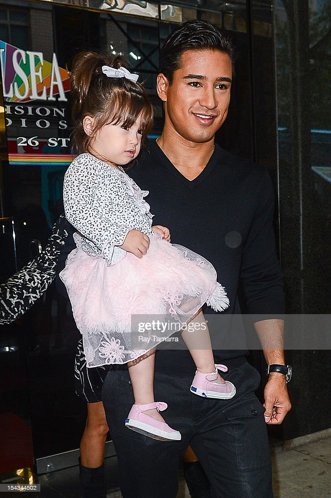 TV personality <a gi-track='captionPersonalityLinkClicked' href=/galleries/search?phrase=Mario+Lopez&family=editorial&specificpeople=235992 ng-click='$event.stopPropagation()'>Mario Lopez</a> (R) and Gia Francesca Lopez leave the 'Wendy Williams Show' taping at the Chelsea Studios on October 18, 2012 in New York City.