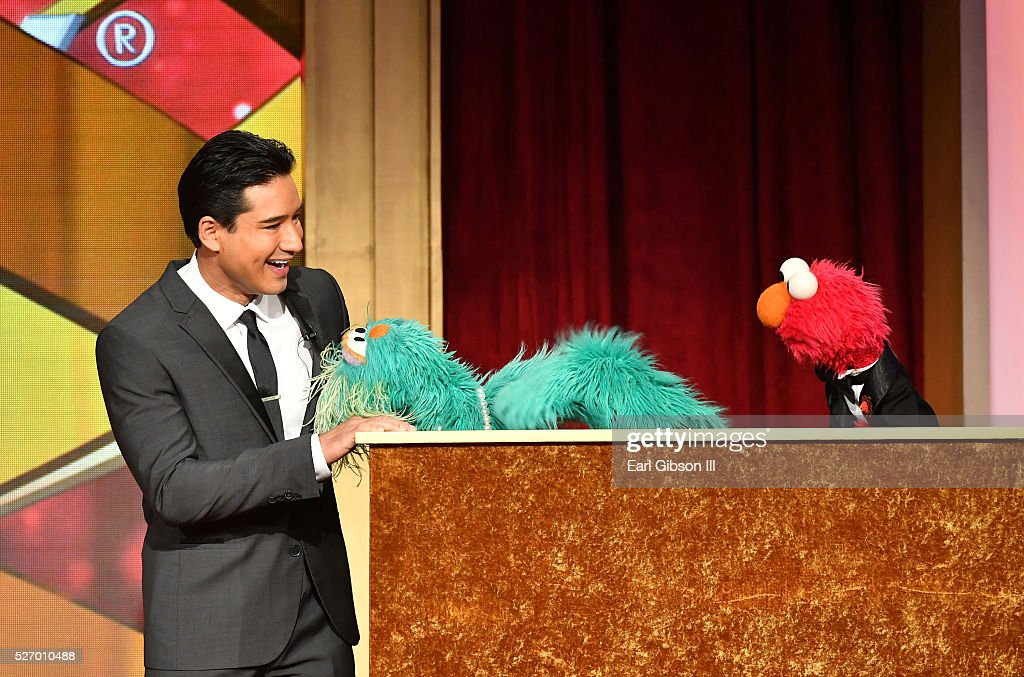 TV personality Mario Lopez with muppets Rosita and Elmo speak onstage at the 43rd Annual Daytime Emmy Awards at the Westin Bonaventure Hotel on May 1, 2016 in Los Angeles, California.