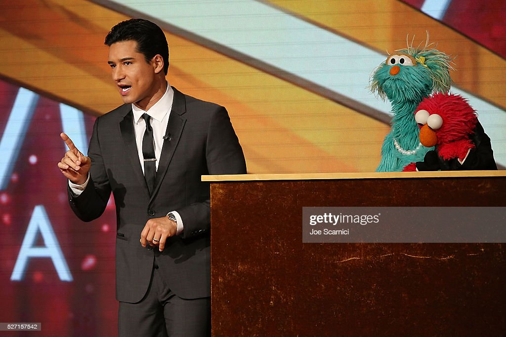 TV personality <a gi-track='captionPersonalityLinkClicked' href=/galleries/search?phrase=Mario+Lopez&family=editorial&specificpeople=235992 ng-click='$event.stopPropagation()'>Mario Lopez</a> with muppets Rosita and Elmo speak onstage at the 43rd Annual Daytime Emmy Awards at the 2016 Daytime Emmy Awards at Westin Bonaventure Hotel on May 1, 2016 in Los Angeles, California.