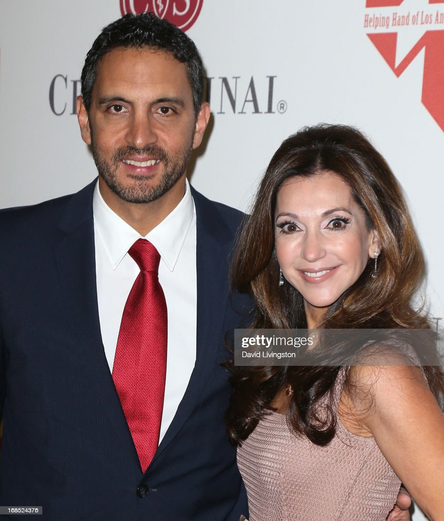 TV personality Mauricio Umansky (L) and Lea Porter attend The Helping Hand of Los Angeles' Annual Mother's Day Luncheon at the Beverly Hills Hotel on May 10, 2013 in Beverly Hills, California.