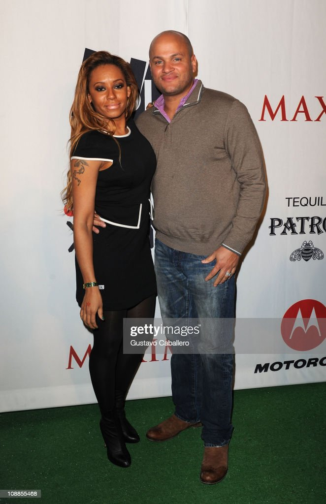 TV Personality <a gi-track='captionPersonalityLinkClicked' href=/galleries/search?phrase=Melanie+Brown&family=editorial&specificpeople=159736 ng-click='$event.stopPropagation()'>Melanie Brown</a> and husband <a gi-track='captionPersonalityLinkClicked' href=/galleries/search?phrase=Stephen+Belafonte&family=editorial&specificpeople=4361206 ng-click='$event.stopPropagation()'>Stephen Belafonte</a> attend the Maxim Party Powered by Motorola Xoom at Centennial Hall at Fair Park on February 5, 2011 in Dallas, Texas.