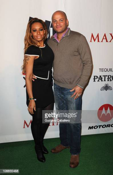 Personality Melanie Brown and husband Stephen Belafonte attend the Maxim Party Powered by Motorola Xoom at Centennial Hall at Fair Park on February 5...