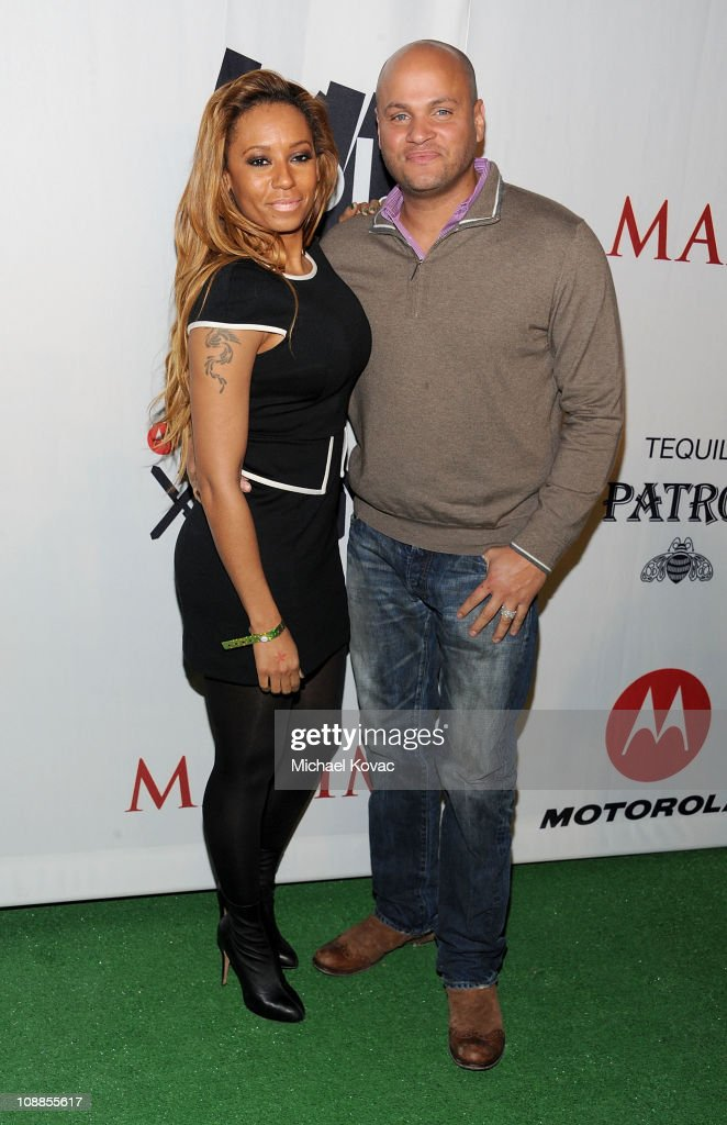 TV Personality Melanie Brown and husband Stephen Belafonte attend the Maxim Party Powered by Motorola Xoom at Centennial Hall at Fair Park on February 5, 2011 in Dallas, Texas.