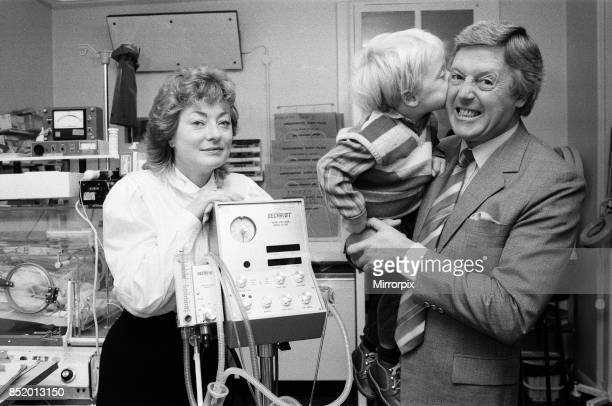 TV personality Michael Aspel who is a vicepresident of Bliss returned to West London Hospital to hand over some equipment to the Special Care Baby...