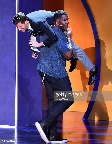 TV personality Michael Strahan and Guiness Official Alex Angert speak onstage at the Nickelodeon Kids' Choice Sports Awards 2015 at UCLA's Pauley...