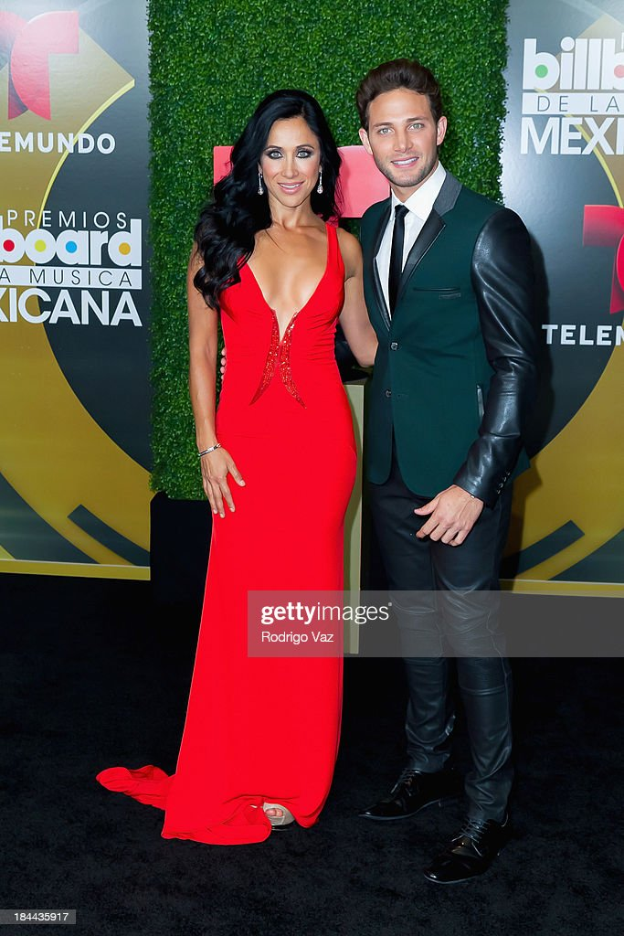 TV personality <a gi-track='captionPersonalityLinkClicked' href=/galleries/search?phrase=Monica+Noguera&family=editorial&specificpeople=240248 ng-click='$event.stopPropagation()'>Monica Noguera</a> (L) and actor Gabriel Coronel attend the 2013 Billboard Mexican Music Awards Press Room at Dolby Theatre on October 9, 2013 in Hollywood, California.