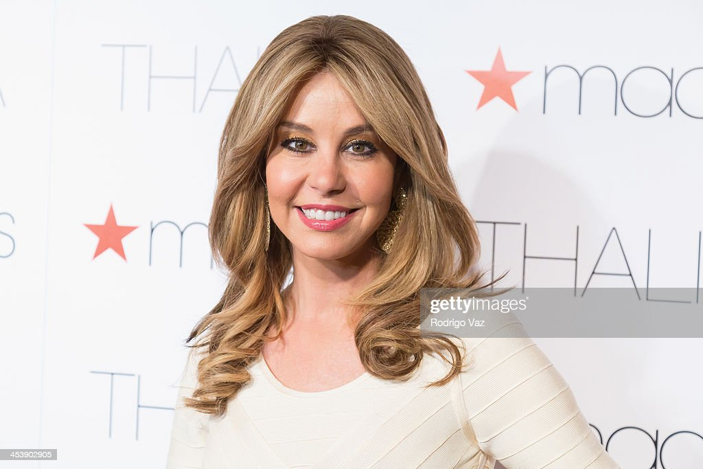 TV personality <a gi-track='captionPersonalityLinkClicked' href=/galleries/search?phrase=Myrka+Dellanos&family=editorial&specificpeople=207066 ng-click='$event.stopPropagation()'>Myrka Dellanos</a> arrives as Macy's honors Latin superstar Thalia at Sunset Tower on December 5, 2013 in West Hollywood, California.