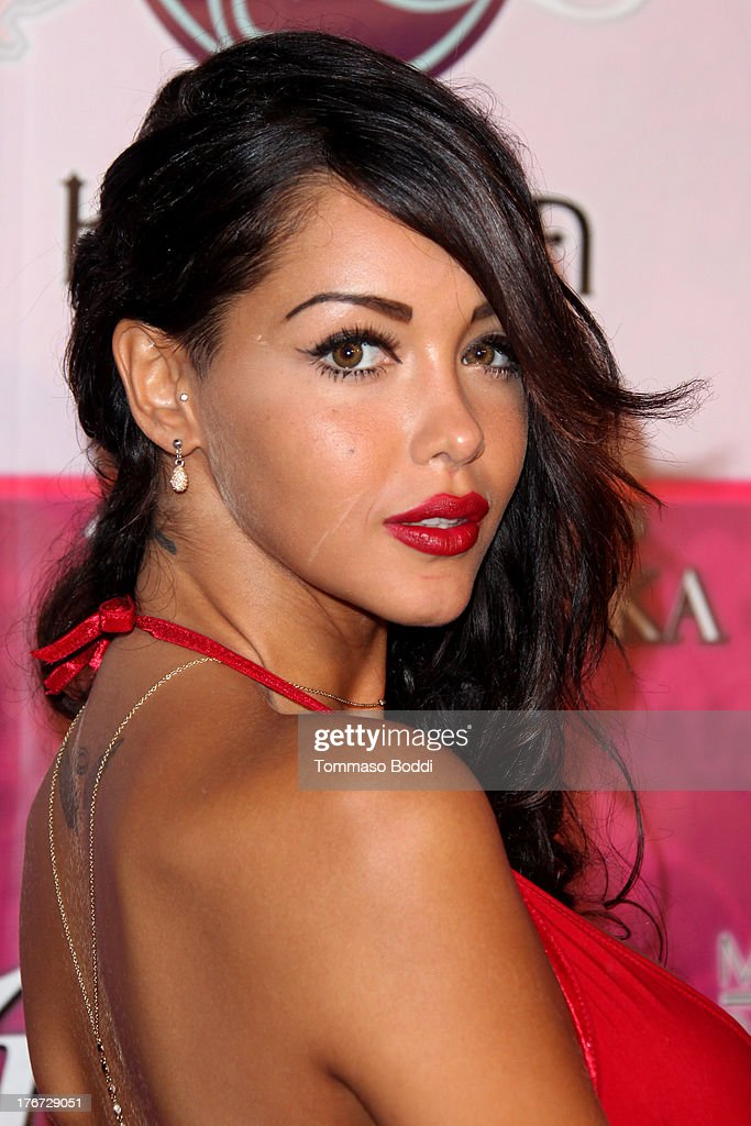 TV personality <a gi-track='captionPersonalityLinkClicked' href=/galleries/search?phrase=Nabilla+Benattia&family=editorial&specificpeople=9537253 ng-click='$event.stopPropagation()'>Nabilla Benattia</a> attends the Karma International presents Kandyland 2013: 'An Evening Of Decadent Dreams' benefiting of Generation Rescue on August 17, 2013 in Beverly Hills, California.