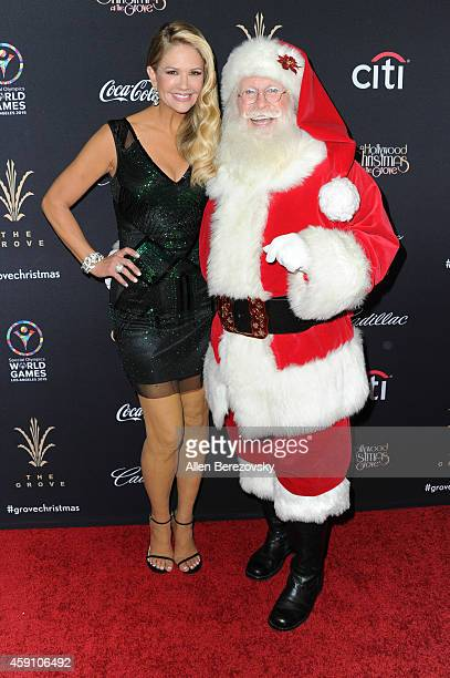 TV personality Nancy O'Dell and Santa Claus attend The Grove's 12th Annual Christmas Tree Lighting Spectacular at The Grove on November 16 2014 in...