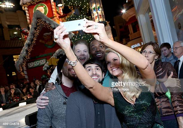 TV personality Nancy O'Dell takes a selfie with the band Pentatonix at The Grove's 12th Annual Christmas Tree Lighting Spectacular Presented By Citi...
