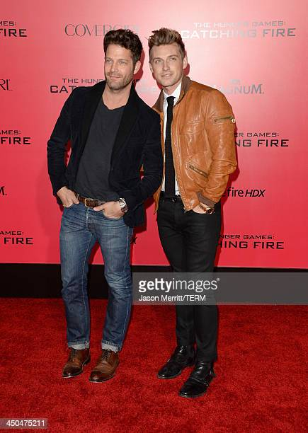 TV personality Nate Berkus and guest arrive at the premiere of Lionsgate's 'The Hunger Games Catching Fire' at Nokia Theatre LA Live on November 18...