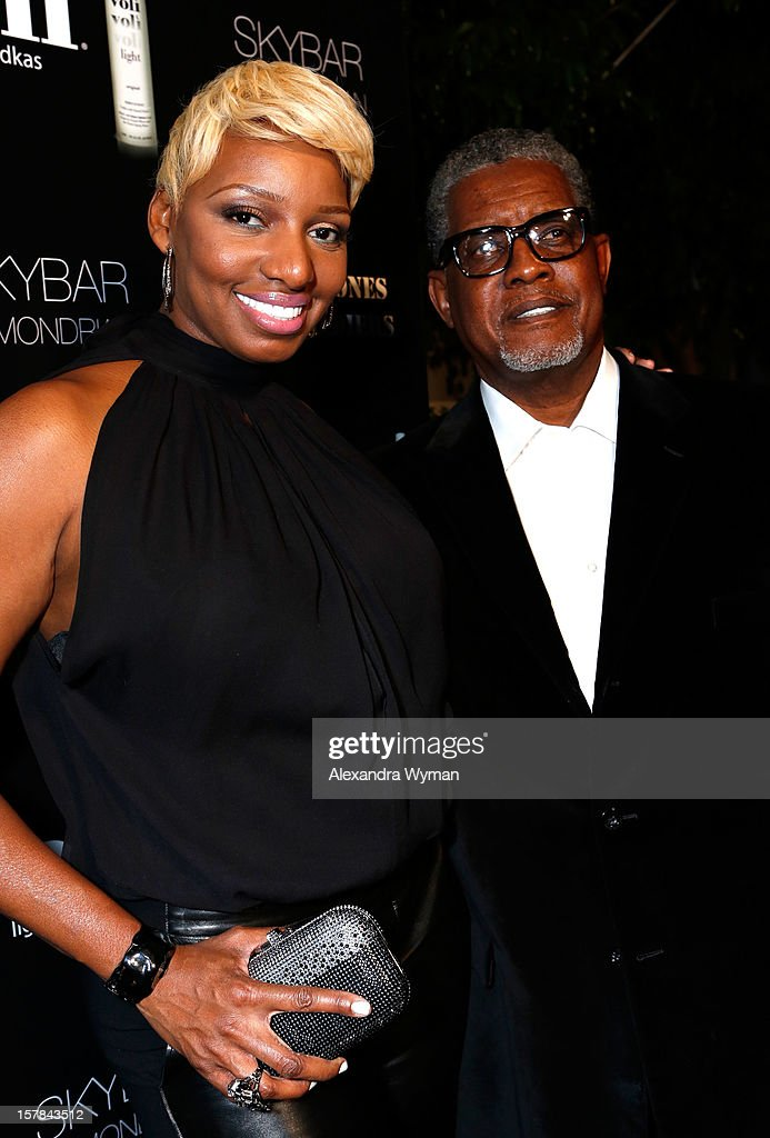 TV personality Nene Leakes and Gregg Leakes attend Voli Light Vodka's Holiday Party hosted by Fergie Benefiting Cellphones for Soldiers at SkyBar at the Mondrian Los Angeles on December 6, 2012 in West Hollywood, California.