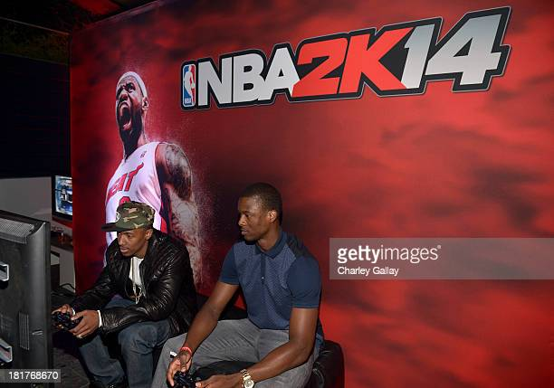 TV personality Nick Cannon and professional basketball player Harrison Barnes attend the NBA 2K14 premiere party at Greystone Manor on September 24...