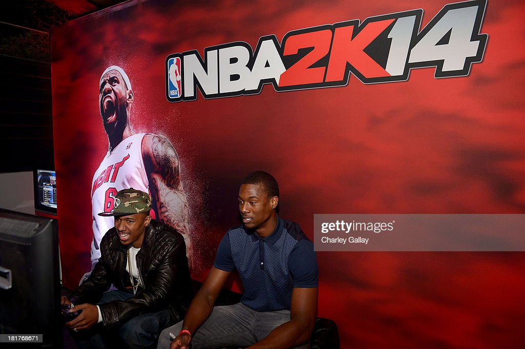 TV personality Nick Cannon (L) and professional basketball player Harrison Barnes attend the NBA 2K14 premiere party at Greystone Manor on September 24, 2013 in West Hollywood, California.