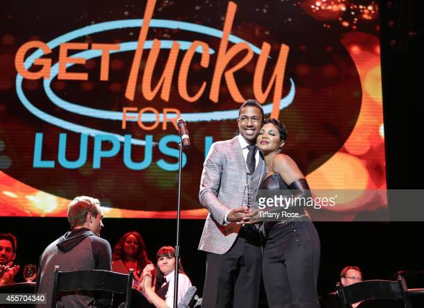 TV personality Nick Cannon and singer Toni Braxton attend Get Lucky For Lupus LA on September 18 2014 in Beverly Hills California