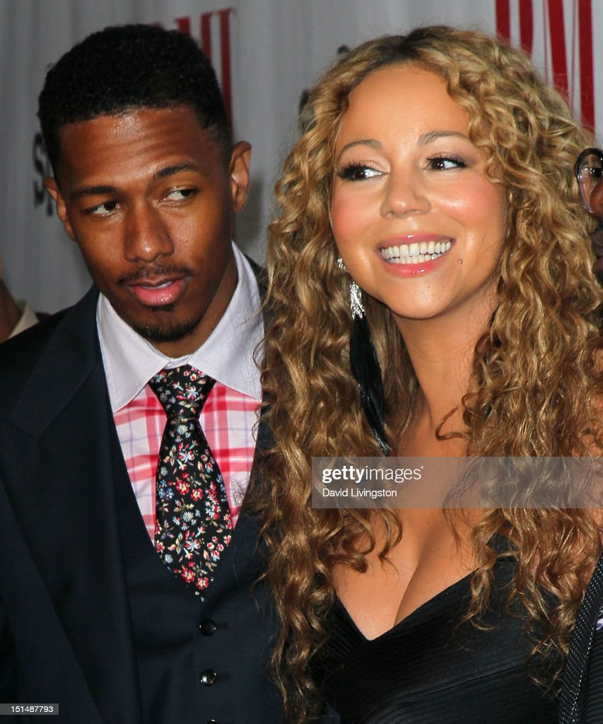 TV personality <a gi-track='captionPersonalityLinkClicked' href=/galleries/search?phrase=Nick+Cannon&family=editorial&specificpeople=202208 ng-click='$event.stopPropagation()'>Nick Cannon</a> (L) and wife recording artist <a gi-track='captionPersonalityLinkClicked' href=/galleries/search?phrase=Mariah+Carey&family=editorial&specificpeople=171647 ng-click='$event.stopPropagation()'>Mariah Carey</a> attend the 12th Annual BMI Urban Awards at the Saban Theatre on September 7, 2012 in Beverly Hills, California.