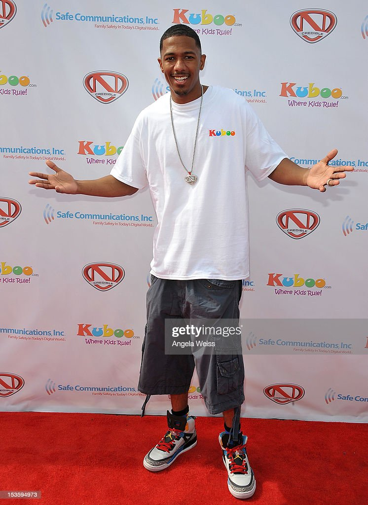 TV personality <a gi-track='captionPersonalityLinkClicked' href=/galleries/search?phrase=Nick+Cannon&family=editorial&specificpeople=202208 ng-click='$event.stopPropagation()'>Nick Cannon</a> arrives at 'Family Day' hosted by <a gi-track='captionPersonalityLinkClicked' href=/galleries/search?phrase=Nick+Cannon&family=editorial&specificpeople=202208 ng-click='$event.stopPropagation()'>Nick Cannon</a> at Santa Monica Pier on October 6, 2012 in Santa Monica, California.