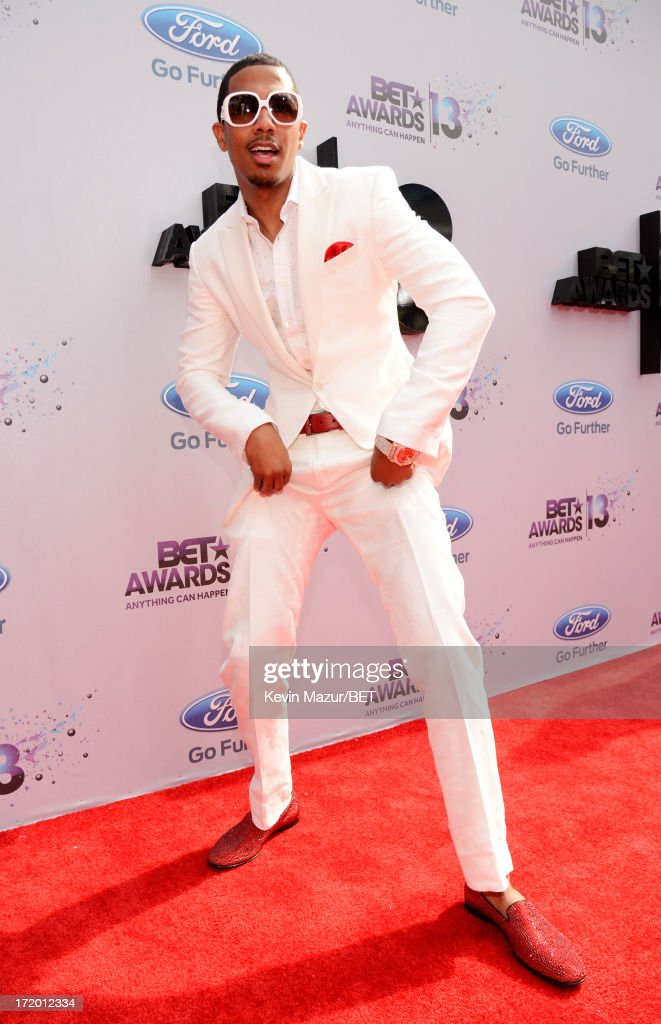 TV personality <a gi-track='captionPersonalityLinkClicked' href=/galleries/search?phrase=Nick+Cannon&family=editorial&specificpeople=202208 ng-click='$event.stopPropagation()'>Nick Cannon</a> attends the Ford Red Carpet at the 2013 BET Awards at Nokia Theatre L.A. Live on June 30, 2013 in Los Angeles, California.