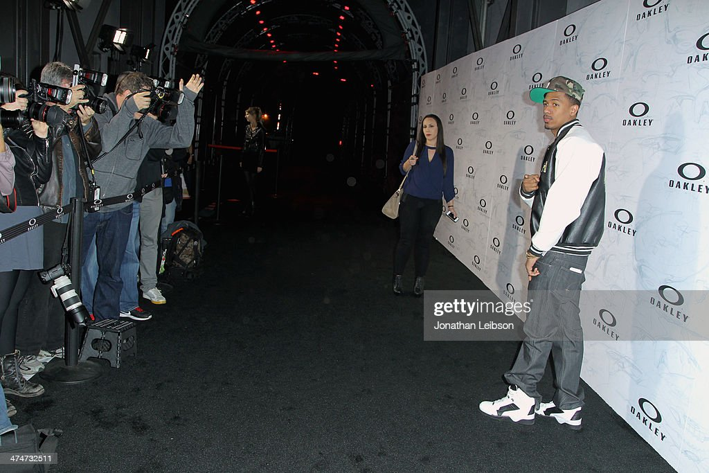 TV personality <a gi-track='captionPersonalityLinkClicked' href=/galleries/search?phrase=Nick+Cannon&family=editorial&specificpeople=202208 ng-click='$event.stopPropagation()'>Nick Cannon</a> celebrates the past, present and future of Oakley's design and technology at the brand's 'Disruptive by Design' global campaign launch event at RED Studios on February 24, 2014 in Los Angeles, California.