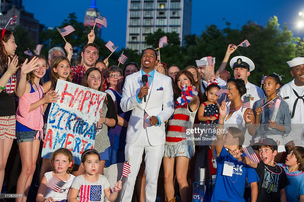 TV personality <a gi-track='captionPersonalityLinkClicked' href=/galleries/search?phrase=Nick+Cannon&family=editorial&specificpeople=202208 ng-click='$event.stopPropagation()'>Nick Cannon</a> (C) hosts the 37th annual Macy's 4th of July Fireworks over the Hudson River on July 4, 2013 in New York City.