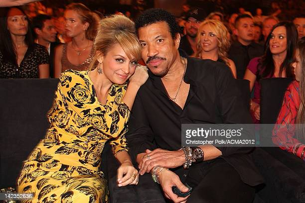 Personality Nicole Richie and singer Lionel Richie attend Lionel Richie and Friends in Concert presented by ACM held at the MGM Grand Garden Arena on...