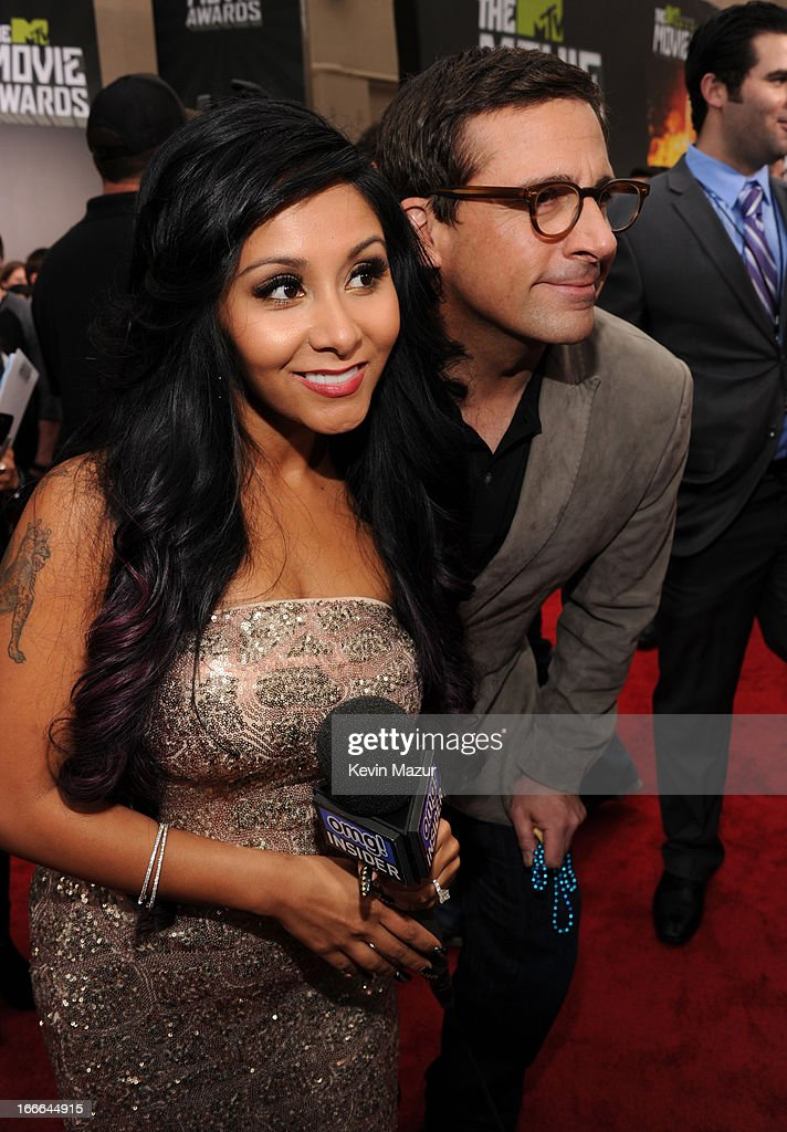 TV personality Nicole 'Snooki' Polizzi (L) and actor Steve Carell arrive at the 2013 MTV Movie Awards at Sony Pictures Studios on April 14, 2013 in Culver City, California.