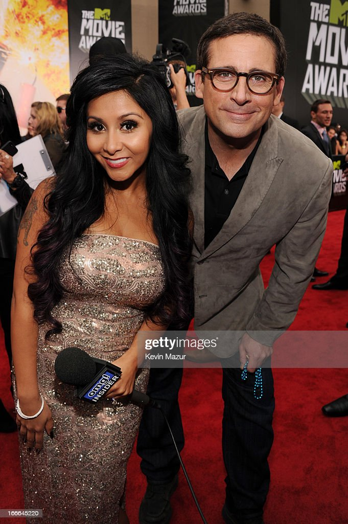 TV personality Nicole 'Snooki' Polizzi (L) and actor Steve Carell arrives at the 2013 MTV Movie Awards at Sony Pictures Studios on April 14, 2013 in Culver City, California.