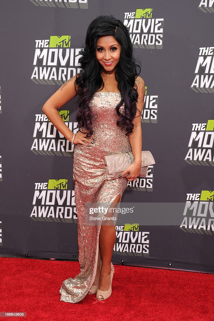 TV personality Nicole 'Snooki' Polizzi arrives at the 2013 MTV Movie Awards at Sony Pictures Studios on April 14, 2013 in Culver City, California.