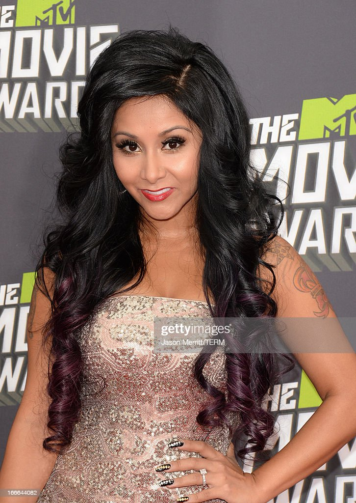TV personality Nicole 'Snooki'' Polizzi arrives at the 2013 MTV Movie Awards at Sony Pictures Studios on April 14, 2013 in Culver City, California.