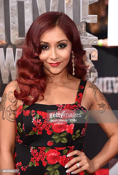 TV personality Nicole Snooki Polizzi attends the 2014 MTV Movie Awards at Nokia Theatre LA Live on April 13 2014 in Los Angeles California